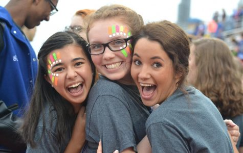 Choir paints their faces before they sing the National Anthem at the game against Katy on September 22