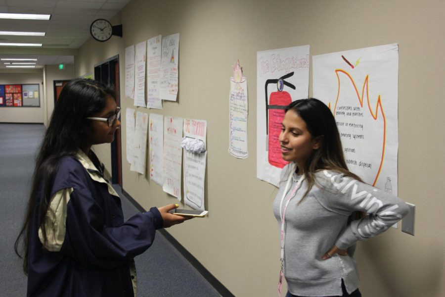 Fiza Kuzhiyil, reporter, talking to Alyssa Serna for Humans of Clear Springs.