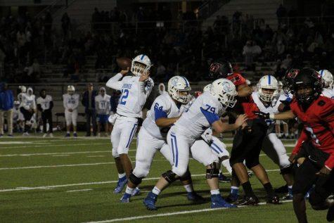 Quarterback Garrett Rooker targets a receiver downfield.